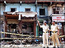 Indian policemen guard the bomb site in 2003