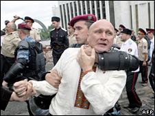 Protester held by policeman at Kiev airport (27 July 2009)