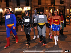 People dressed as super-heroes make a fake security patrol in Milan to criticise the new security law (16 July 2009)