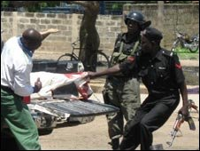 Police in Maiduguri pull a body from a truck, 27/07