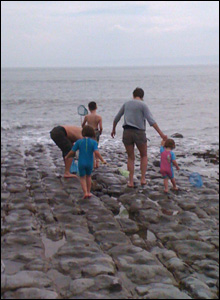 Huw Evans' daughter Helen and her family rock pooling at Llantwit Major.