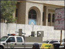 A police car stands outside the Rafidain bank in Baghdad's Karrada district on 28 July, after the robbery there