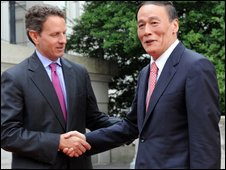 US Treasury Secretary Timothy Geithner (L) greets Chinese vice premier Wang Qishan