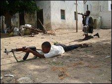 Somali child soldier in training