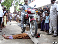 A man driving a motorcycle over a girl student at a school in Tamil Nadu on 15 July
