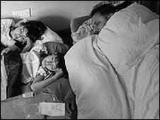 Father sharing room with two children (models)