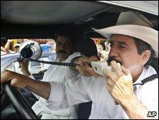 Manuel Zelaya talks to supporters in Nicaragua on 25 July