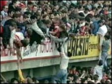 People being lifted over the stands at Hillsborough 20 years ago