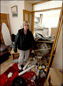 Julie Miller surveys the damage to her home (Photo: D Legakis Photography / Athena Picture Agency)