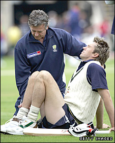Glenn McGrath has his ankle tended to by physio Erol Alcott in 2005