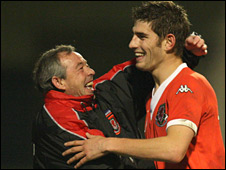 Wales Under-21 manager Brian Flynn with Ched Evans