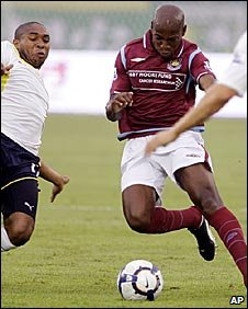 Luis Boa Morte in action against Tottenham in Beijing