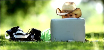 Woman using a laptop in a park