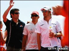 Mark Webber of Australia and Red Bull Racing, Lewis Hamilton of Great Britain and McLaren Mercedes and Jenson Button of Brawn