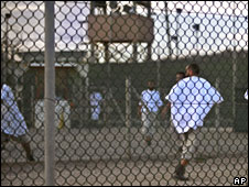 Detainees jog at dusk inside the exercise yard at Camp 4 detention facility, Guantanamo Bay (file picture)