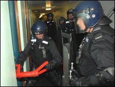 Police carry out a drugs raid in Hampshire