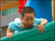 Child playing in Beijing, China
