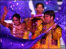 Bollywood performers take part in a Delhi 2010 show to mark the next Commonwealth Games, as part of the closing ceremony for the 2006 Commonwealth Games at the Melbourne Cricket Ground