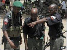 Soldiers inspecting the dead, Maiduguri, 29/07