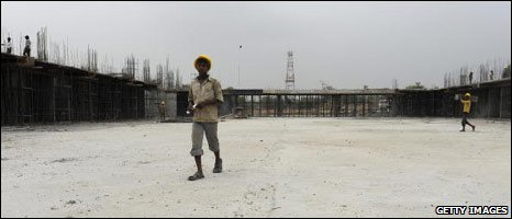 May 09: A worker at the site of the badminton stadium in Delhi