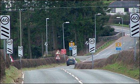 Road signs in Llanerfyl, Powys
