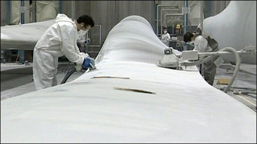 Workers making wind turbine blades