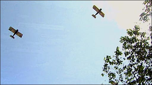 Two SE5A biplanes fly over the church where Henry Allingham's funeral was held