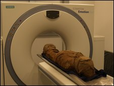 Mummy being inserted into scanner