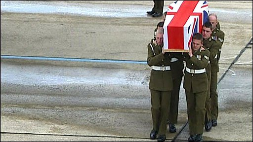 The coffin is carried of Bombardier Craig Hopson