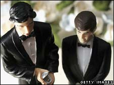 Same-sex statues on the top of a wedding cake