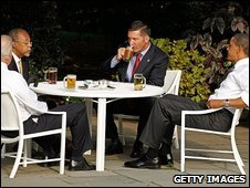 US Vice-President Joe Biden, Harvard University Professor Henry Louis Gates, Cambridge Police Sgt James Crowley and President Barack Obama drink beer and talk at the White House, 30 July 2009