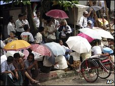 People gather near Insein Prison in Rangoon, 28 July 2009