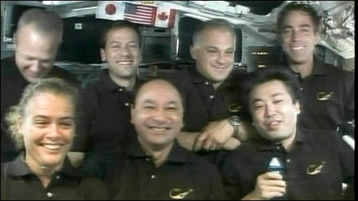 Astronaut Koichi Wakata (far right) and other crew members
