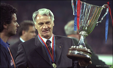 Bobby Robson holds the European Cup Winners' Cup in 1997, watched by his assistant Jose Mourinho (left)