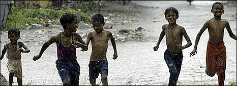 Children playing in the rain (Image: BBC)