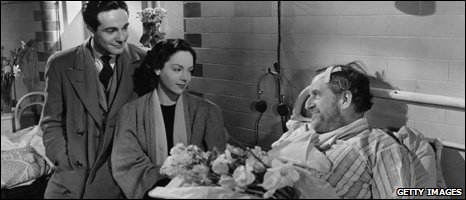 Stanley Holloway with Natasha Parry in a scene from the film 'Midnight Episode'