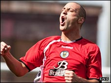Billy Mehmet celebrates against Shire