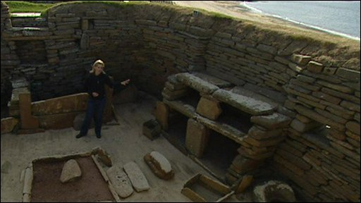 Lorna Gordon inside a Stone Age house