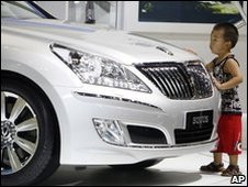 Young boy checks out the Hyundai Equus car
