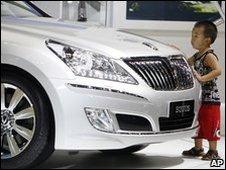 Young boy checks out the Hyundai Equus car