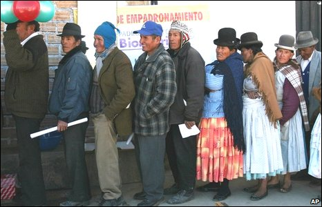 Bolivians queue to be issued with a new biometric voter identification system on 1 August