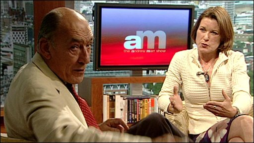 Sir Mike Jackson turns to throw his phone away as he is interviewed by Stephanie Flanders