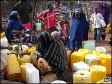 Refugees gather at a water tap in Dadaab