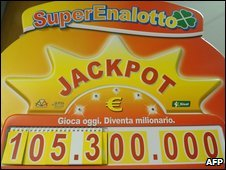 An advertising board shows the rising jackpot total in Italy's SuperEnalotto lottery on 25 July, 2009
