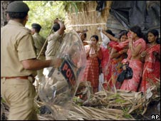 A policeman beats women teachers protesting in Patna, India, on July 10, 2009.