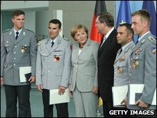 German Chancellor Angela Merkel with German Defence Minister Franz Josef Jung and (from L to R) Staff Sergeant Jan Berges, Sergeant Major Markus Geist, Staff Sergeant Alexander Dietzen and Staff Sergeant Henry Lukacz of the German Bundeswehr on July 6, 2009 in Berlin, Germany