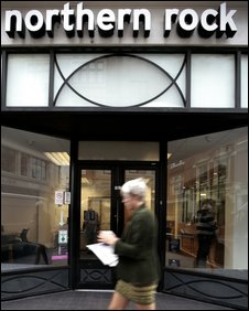 A woman walks past a Northern Rock branch