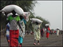Women collect food aid in Akobo, Southern Sudan