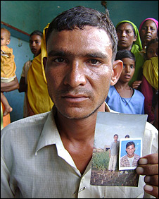 Rajender with photograph of his brother
