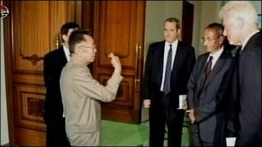 Still of Bill Clinton and Kim Jong-il on North Korean TV